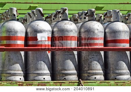 Aluminum gas containers in a row outdoor