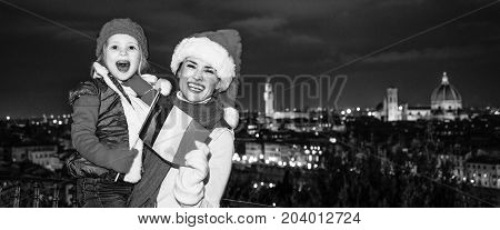 Mother And Daughter In Christmas Hats In Florence Showing Flag