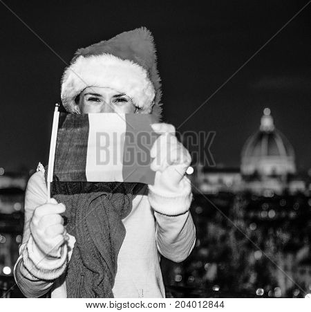 Happy Woman In Christmas Hat In Florence Showing Flag
