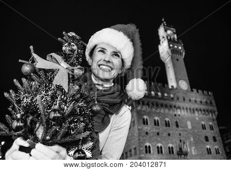 Tourist Woman With Christmas Tree Looking Into Distance, Italy