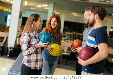 Friends having fun while bowling and speding time together