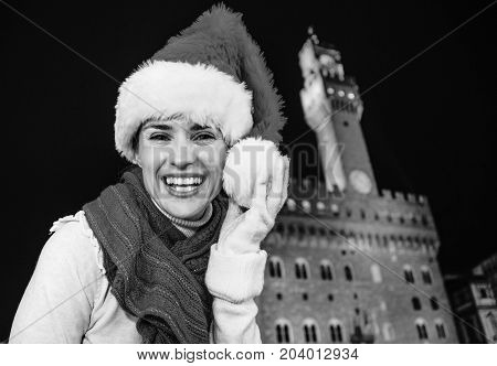 Woman In Christmas Hat Near Palazzo Vecchio Having Fun Time