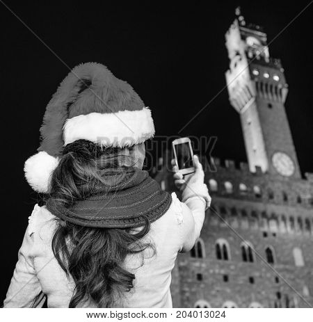 Woman In Christmas Hat In Florence With Cellphone Taking Photo