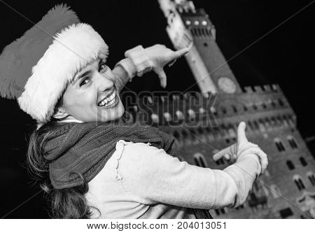 Woman In Christmas Hat Near Palazzo Vecchio Framing With Hands