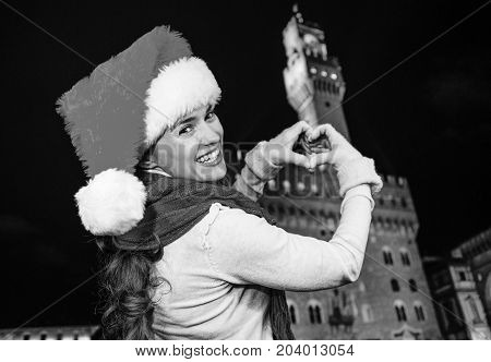 Woman In Christmas Hat In Florence Showing Heart Shaped Hands