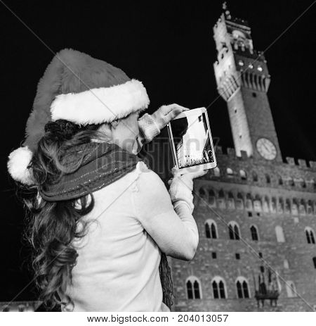 Woman In Christmas Hat In Florence Taking Photo With Tablet Pc