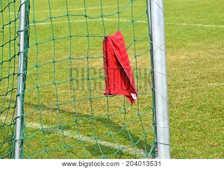 Goalpost and net with a towel on it