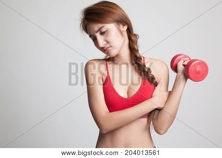 Asian Healthy Girl Got Arm Pain With Dumbbell.