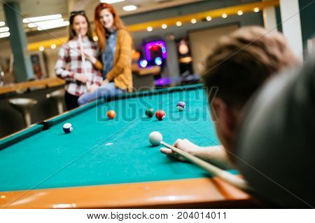 Friends playing snooker in their spare time