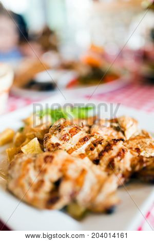 Grilled poultry meat with vegetables served in restaurant