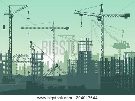 Tower cranes on construction site. Buildings under construction