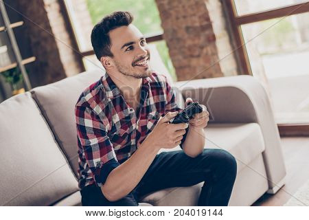 Portrait Of Attractive Brunet Hipster With Bristle, Holding Joy Stick And Playing Videogames On Tv A