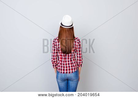 Back View Snap Model Shot Of Young Brunette Woman In Casual Outfit And Hat, Standing On Pure Light G