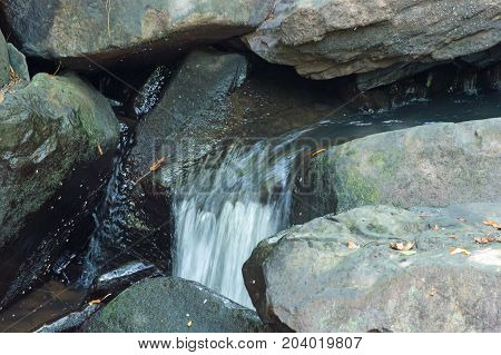 The photographer captured a silky water effect with this little waterfall amongst big rocks in a stream in Arkansas.