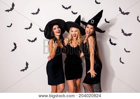 Boo! Three Terrifyng Mysterious Emotional Flirty Dark Mistress Monsters In Elegant Costume Clothing,