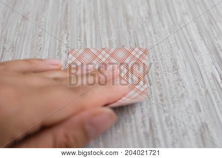 playing cards in a people hand. Close-up of a poker player holding playing cards