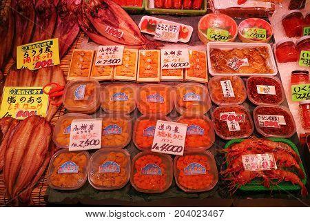 Otaru Japan - July 26 2017 : Various seafood ingredients such as fish crabs shrimp prawn squid octopus sea urchin uni in local fish market popular tourist destination.