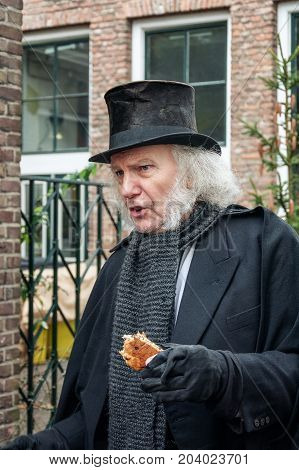 Deventer Netherlands - December 18 2016: Scrooge one of the characters from the famous books of Dickens during the Dickens Festival in Deventer in The Netherlands