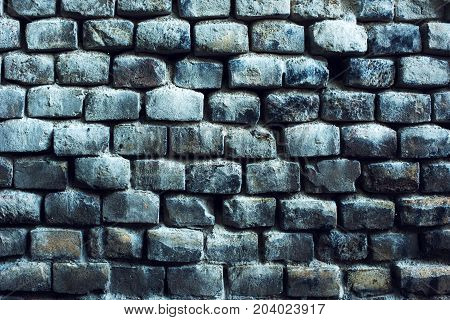 Old brick wall background with weather worn surface pattern