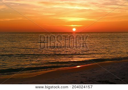 Sunset over the Gulf of Mexico on a beach in Florida