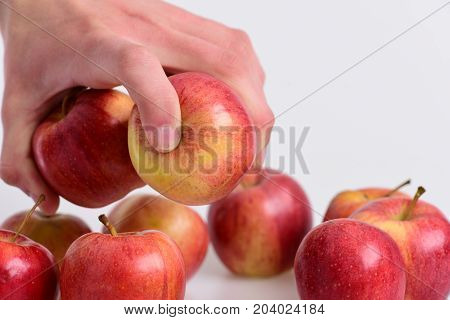 Food And Healthy Lifestyle Concept. Male Hand Grabs Red Apples