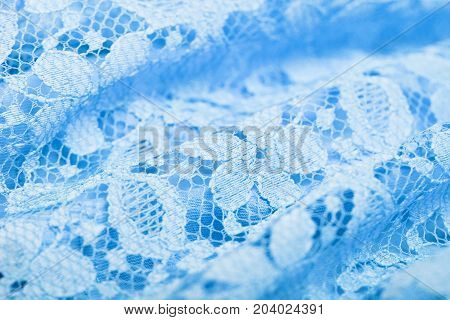 Texture of blue lace. Delicate gypery. A good background on topics related to fabrics linen needlework etc.
