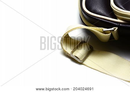 The Brown Bag With The Strap On White Background