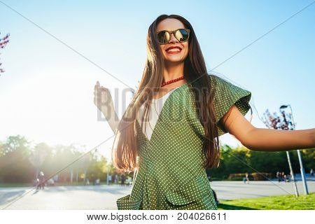 Happy smiling shine young girl,joy,enjoy life,freedom summer shine concept. Sunglasses