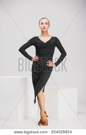 cute girl in black dress posing in studio, beautiful dancer posing indoor