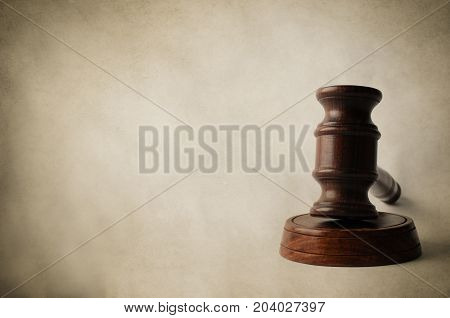 Gavel On Block With Aged Parchment Background
