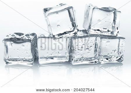 Transparent ice cubes with reflection and water drops on white background, isolated. Closeup of cold crystal blocks group cutout