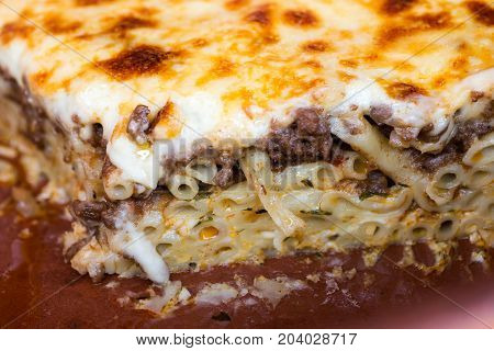 Pastitsio Traditional Greek Baked Pasta Casserole With Ground Beef Tomatoes Feta Cheese and Bechamel Sauce