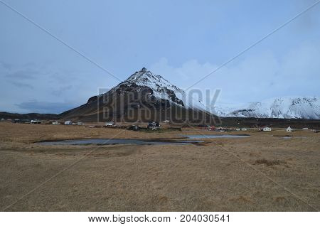 Arnastapi village and mount Stapafell in Iceland.