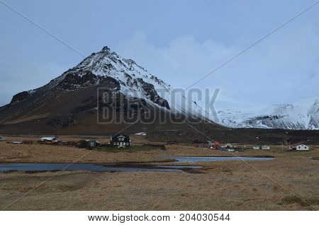 Beautiful look at a village at the base of a mountainin Iceland.