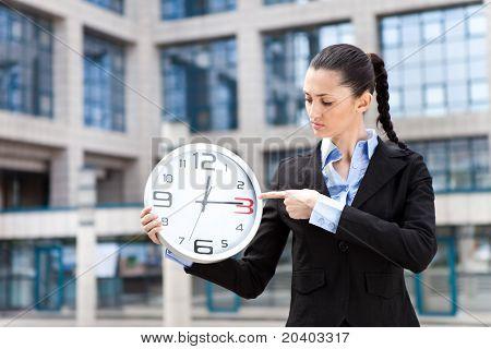Business Woman Holding Analog Clock