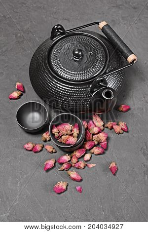 Asian Black Traditional Teapot With Dry Roses For Tea Ceremony