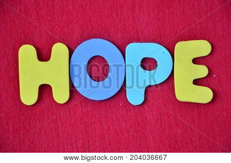 word hope on a  a red background