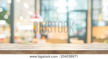 Empty Wooden Table Top With Blur Coffee Shop Or Restaurant Interior Background, Panoramic Banner. Ca