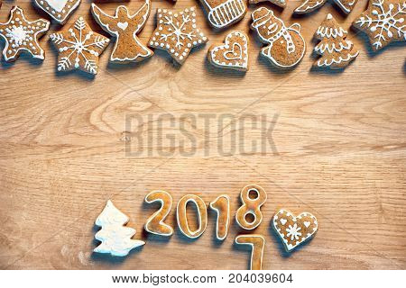 Merry X-mas! Homemade cookies on wooden background. Copy space for your text. Top view. High resolution product