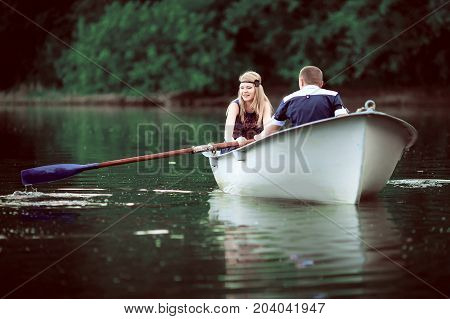 tender couple boating on lake, man and woman have holiday on lake, romantic people have quite vocation