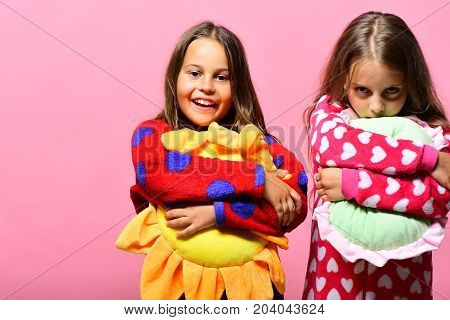 Girls With Loose Hair Hug Their Pillows. Childhood And Friendship