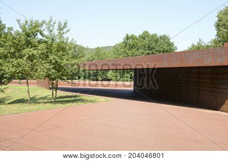 OLOT, SPAIN - JULY 28, 2017: Part of the pavilion of the athletics track designed by RCR architects located in Olot in the Province of Girona Catalonia Spain.