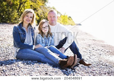 Casual Young Family On The Beach