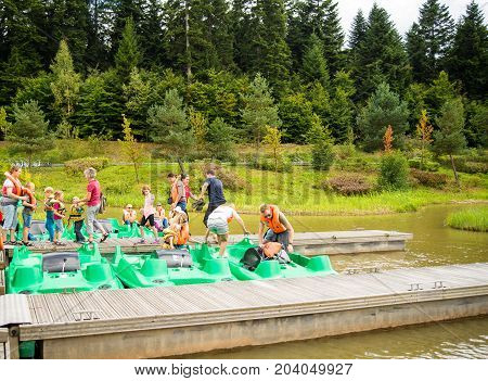 SarrebourgFrance-September 52017: Families disembark from pedal boats on a lake in a park