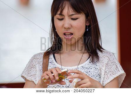 Japanese Woman Have Bad News On Her Cell Phone At Miyajima (itsukushima ) Island.  Japan