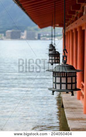 Traditional japanese lanterns in Itsukushima Shrine Miyajima island Japan