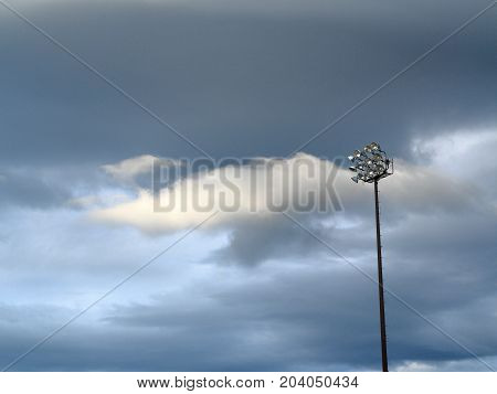 Light Tower - Outdoor sports lighting tower and cloudy blue sky.