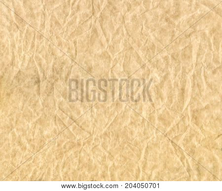 Texture of crumpled paper. Brown crumpled parchment