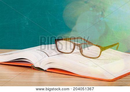 Black reading glasses reading glasses close up book shelves table