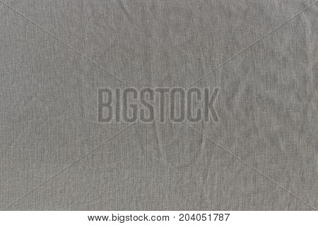 The wrinkled texture of linen cloth brown